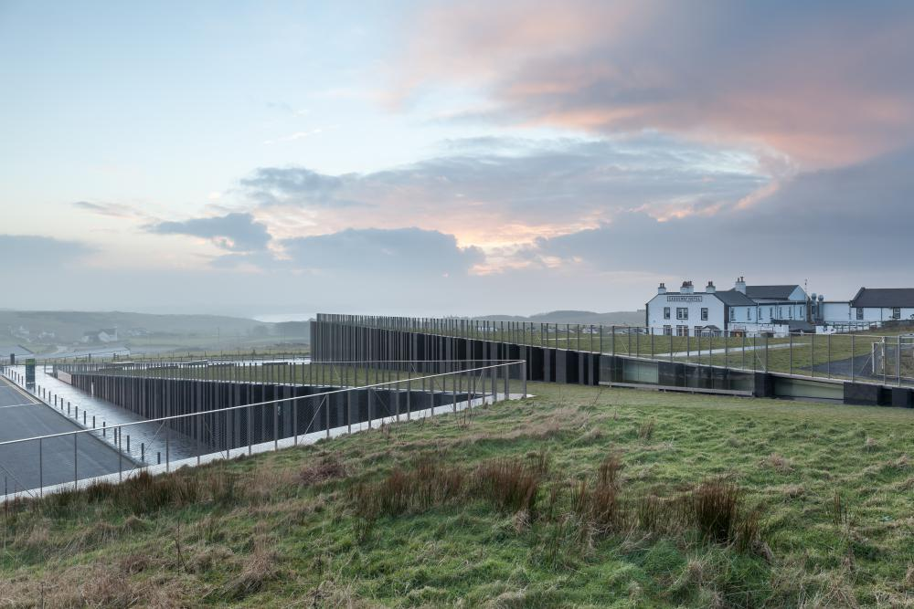 Cover photo of image set from Giants Causway Visitor Centre, designed by Heneghan Peng Architects and located in Bushmills, United Kingdom. All photos by Pawel Paniczko Architectural Photography